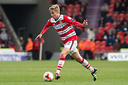 Doncaster Rovers Forward Will Longbottom (22) in action during the EFL Sky Bet League 2 match between Doncaster Rovers and Blackpool at the Keepmoat Stadium, Doncaster, England on 17 April 2017. Photo by Craig Zadoroznyj.