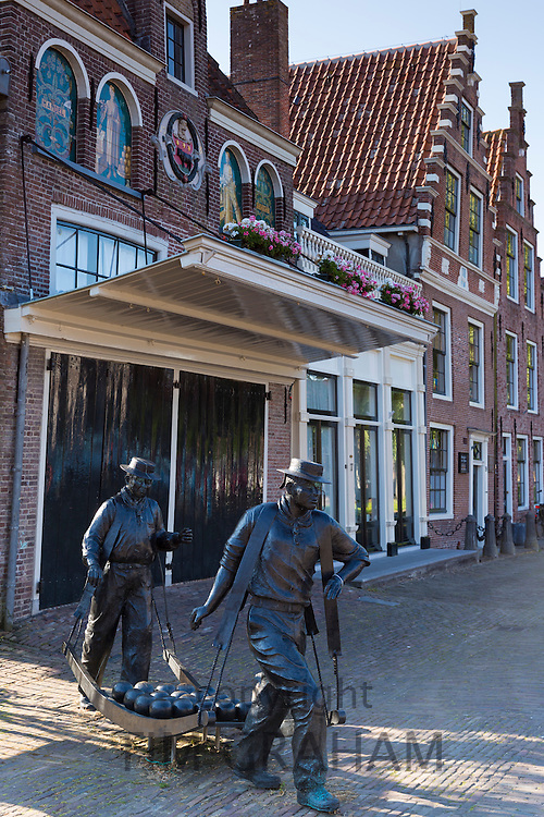 Bronze statue cheese porters / carriers in Kaasmarkt cheese market, Kaasmarkten in Edam, The Netherlands