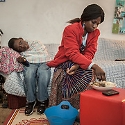 "Atlanta, Georgia/Central Africa Republic Refugee/Nestorine Lakas, 27, feeds her son Eric who has cerebral palsy, at their apartment in Atlanta. Nestorine arrived in the U.S. in 2010 with her two young children from the Central African Republic. Her son, who is now 7 years old, suffers from severe cerebral palsy and requires a wheelchair and specialized healthcare. At the IRC in Atlanta, Nestorine is part of the Temporary Assistance for Needy Families (TANF) program where she is learning English, job skills and basic computer literacy so she can support her family as a single mom and learn how to manage her son's health needs. Unfortunately the father of Nestorine's children was not able to come to the U.S. with her, so she cares for her children and dreams of reuniting with him someday. Nestorine believes what makes her successful is ?working hard and overcoming challenges?. ""There was a war in my country and I fled to Cameroon. I was pregnant with my older son and gave birth along the way. When I fled I was alone. When I got to the camp I found my husbands name on a sign at the camp and we were reunited. My daughter Carol was born in Cameroon."" Because of her son's disability Nestorine got a humanitarian visa with the help of UNHCR. ""I am very happy to be here because they helped me a lot with my child. If I had stayed in CAR there isn't the healthcare that I have here. I am very thankful. The reason my child is still alive because I came as a refugee. Maybe the child would not have had any hope to walk. I hope one day he might walk.""."