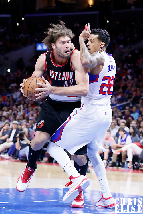 08 November 2014: Portland Trail Blazers center Robin Lopez (42) drives past Los Angeles Clippers forward Matt Barnes (22) during the Los Angeles Clippers 106-102 victory over the Portland Trail Blazers, at the Staples Center, Los Angeles, California, USA.