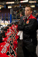 PENTICTON, CANADA - SEPTEMBER 16: Marc Paquet, athletic therapist of Calgary Flames stands on the bench against the Winnipeg Jets on September 16, 2016 at the South Okanagan Event Centre in Penticton, British Columbia, Canada.  (Photo by Marissa Baecker/Shoot the Breeze)  *** Local Caption *** Marc Paquet;