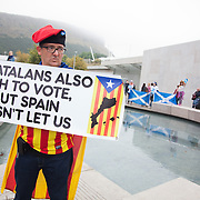 A Spanish activist campaigns in front of the Scottish Parliament for an independent Catalonia.<br />
