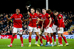 Niclas Eliasson and Josh Brownhill of Bristol City celebrate after Famara Diedhiou of Bristol City scores a goal to make it 0-2 - Rogan/JMP - 07/12/2019 - Craven Cottage - London, England - Fulham v Bristol City - Sky Bet Championship.