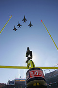 DENVER - JANUARY 22:  Four F-16 US Air Force jets from the 120th Fighter Squadron fly over the stadium after the National Anthem at the Denver Broncos AFC championship game against the Pittsburgh Steelers on January 22, 2006 at INVESCO Field at Mile High in Denver, Colorado. The Steelers defeated the Broncos 34-17. ©Paul Anthony Spinelli