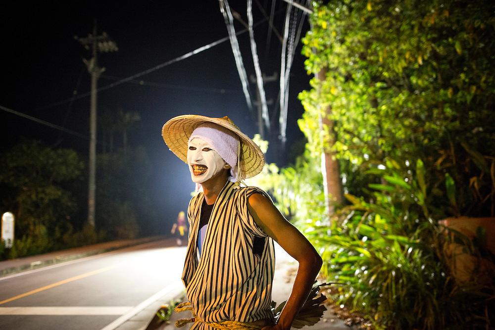 OKINAWA, JAPAN - AUGUST 17 : Chondara clown smile after a modern Eisa folk dance performance in Higashi village during the Obon festival to honour the spirits of their ancestors on August 17, 2016, Okinawa prefecture, Japan.  (Photo by Richard Atrero de Guzman/NURPhoto)