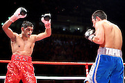 Amir Khan taunts Marco Antonio Barrera during the WBA and WBO Inter-Continental Lightweight title fight between Amir Khan and Marc Antonio Barrera at the MEN Arena on March 14, 2009 in Manchester, England.
