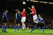 Nemanja Vidic scores the first goal during the UEFA Champions League First Knockout Round Second Leg match between Manchester United and Inter Milan at Old Trafford on March 11 2009, in Manchester, England.
