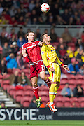 Diego Poyet (Milton Keynes Dons) and Tom Kalas (Middlesbrough FC) challenge for the high ball during the Sky Bet Championship match between Middlesbrough and Milton Keynes Dons at the Riverside Stadium, Middlesbrough, England on 12 September 2015. Photo by George Ledger.
