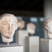 Head of a woman dating to 4th century BC. The Stoa of Attalos is a 1950s recreation of a long pavilion that was originally built around 150 BC. It was part of the Ancient Agora (market). It now houses the Museum of the Ancient Agora, which includes clay, bronze and glass objects, sculptures, coins and inscriptions from the 7th to the 5th century BC, as well as pottery of the Byzantine period and the Turkish conquest.