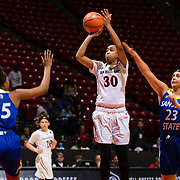 24 February 2018: The San Diego State women's basketball team closes out it's home schedule of the regular season Saturday afternoon against San Jose State. San Diego State Aztecs guard Cheyenne Greenhouse (30) attempts a jump shot in between two Spartan defenders the second half. The Aztecs beat the Spartans 85-78 at Viejas Arena.<br /> More game action at sdsuaztecphotos.com