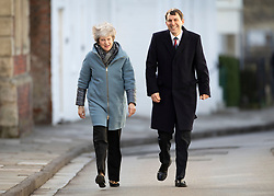 © Licensed to London News Pictures. 04/03/2019. Salisbury, UK. Prime Minister Theresa May walks with John Glen MP during a visit to Salisbury on the first anniversary of the poisoning of former Russian spy Sergei Skripal and his daughter Yulia in March 2018. They both survived the nerve agent attack but a resident of nearby Amesbury, Dawn Sturgess, died in June 2018 after coming in contact with the poison. Two Russians have been named in connection with the attack. Photo credit: Peter Macdiarmid/LNP