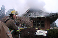 Firefighters work to extinguish a fire at the nearly 100-year-old Pagoda inside Point Defiance Park, in Tacoma, Wash. Friday, April 15, 2011.(Janet Jensen/Staff photographer).