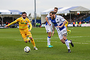 Bristol Rovers Stuart Sinclair(24) clears the ball under pressure from Millwall's David Worrall(7) during the EFL Sky Bet League 1 match between Bristol Rovers and Millwall at the Memorial Stadium, Bristol, England on 30 April 2017. Photo by Shane Healey.