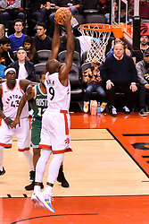October 19, 2018 - Toronto, Ontario, Canada - Serge Ibaka #9 of the Toronto Raptors shoots the ball during the Toronto Raptors vs Boston Celtics NBA regular season game at Scotiabank Arena on October 19, 2018 in Toronto, Canada (Toronto Raptors win 113-101) (Credit Image: © Anatoliy Cherkasov/NurPhoto via ZUMA Press)