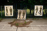 Old Soviet parade ground murals show the physical style of Russian marching techniques in the former Russian Soviet army camp in occupied East Germany (ex-GDR/DDR), on 16th June 19990, on Halb Insel Wustrow, near Rostock, Germany. Wustrow was once a WW2 German anti-aircraft artillery position then housing civilian refugees before the eventual Soviet occupation of the former DDR during the Cold War, up until 1990 and the fall of communism and the Berlin Wall. The camp was ransacked and all its assets stripped before its desertion that summer and is a reminder of a fallen ideology
