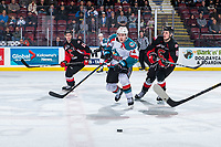 KELOWNA, CANADA - FEBRUARY 8:  Kyle Topping #24 of the Kelowna Rockets is back checked by Jackson Leppard #8 of the Prince George Cougars on February 8, 2019 at Prospera Place in Kelowna, British Columbia, Canada.  (Photo by Marissa Baecker/Shoot the Breeze)