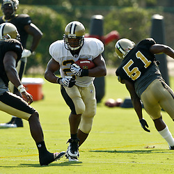 August 2, 2010; Metairie, LA, USA; New Orleans Saints running back Pierre Thomas (23) away from safety Roman Harper (41) during a training camp practice at the New Orleans Saints practice facility. Mandatory Credit: Derick E. Hingle