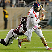 Texas A&M defensive lineman Myles Garrett (15) tackles Mississippi quarterback Bo Wallace (14) during the first half of an NCAA college football game in College Station, Texas, Saturday, Oct. 11, 2014. (Photo/Thomas Graning)