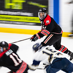 TORONTO, ON - APR 10, 2018: Ontario Junior Hockey League, South West Conference Championship Series. Game seven of the best of seven series between the Georgetown Raiders and the Toronto Patriots, Zac Elson #4 of the Georgetown Raiders follows the play during the first period.<br /> (Photo by Kevin Raposo / OJHL Images)
