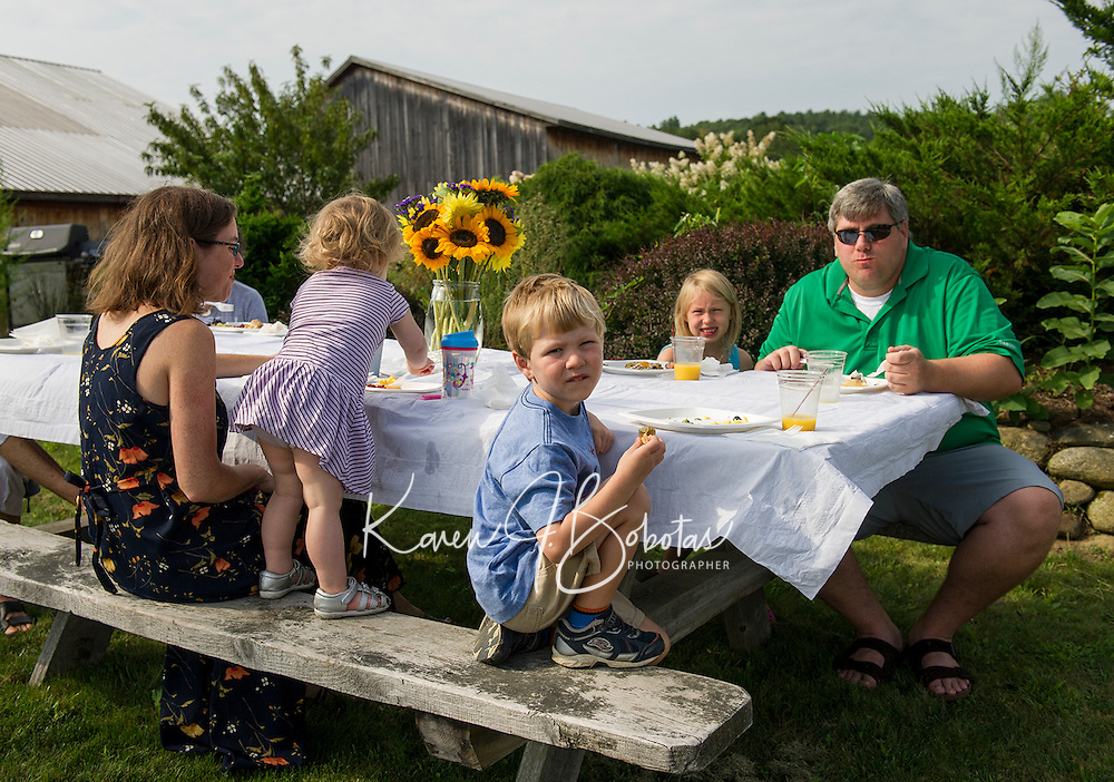 Lauren, Emilty, Matthew, Miya and Gerry Papenhousen enjoy Sunday brunch in the field at Moulton Farm in Meredith.  (Karen Bobotas/for the Laconia Daily Sun)