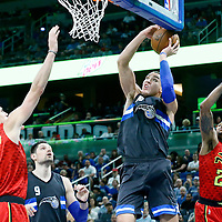25 February 2017: Orlando Magic forward Aaron Gordon (00) goes for the dunk past Atlanta Hawks forward Kent Bazemore (24) during the Orlando Magic 105-86 victory over the Atlanta Hawks, at the Amway Center, Orlando, Florida, USA.