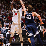 22 December 2018: San Diego State Aztecs forward Nathan Mensah (31) makes an step back jumper over Brigham Young Cougars forward Luke Worthington (41) in the second half. The Aztecs beat the Cougars 90-81 Satruday afternoon at Viejas Arena.