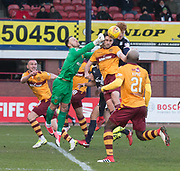 24th February 2018, Dens Park, Dundee, Scotland; Scottish Premier League football, Dundee versus Motherwell; Goalkeeper Trevor Carson and Carl McHugh of Motherwell combine to deny Simon Murray of Dundee