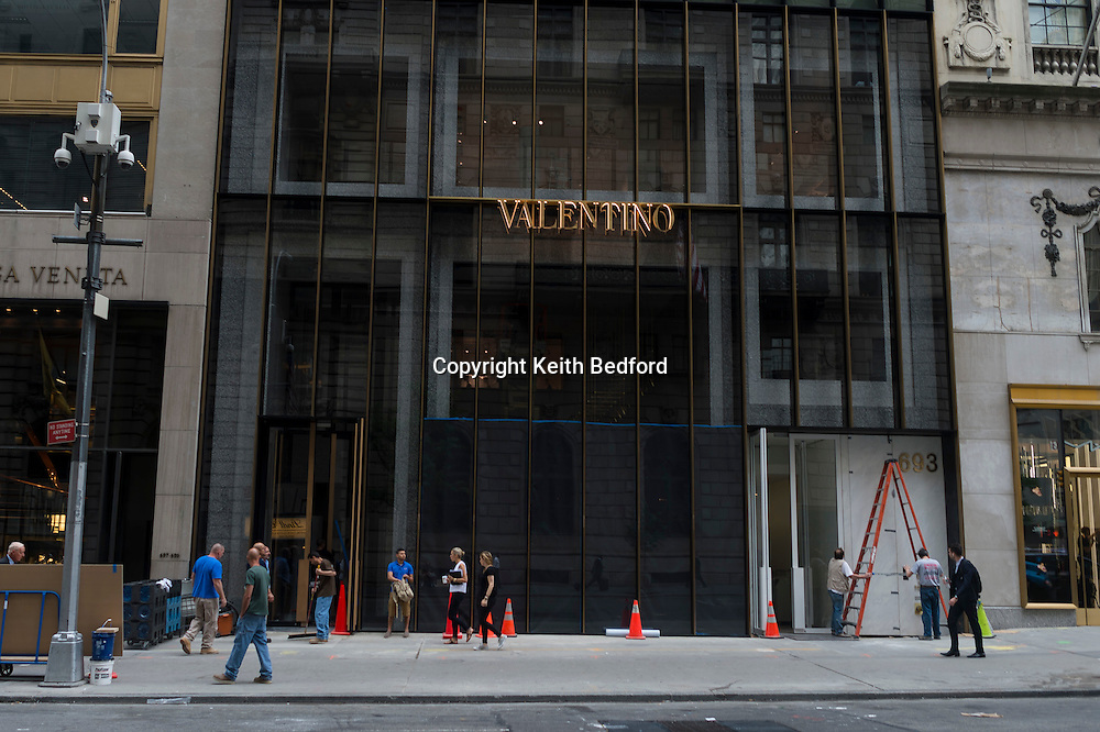 Passersby walk in front of in the Valentino store in the Manhattan Borough of New York, July 31, 2014.  The new Manhattan flag ship store is set to open on Friday August 1, 2014.<br /> <br /> CREDIT Keith Bedford for The Wall Street Journal<br /> <br /> SLUG:NYVALENTINO