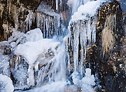 Ice and icicles on a side stream in the Dudh Koshi river valley (or Dudh Kosi) on the trail to Gokyo, in Sagarmatha National Park, in the Himalaya of eastern Nepal. Sagarmatha National Park was created in 1976 and honored as a UNESCO World Heritage Site in 1979.