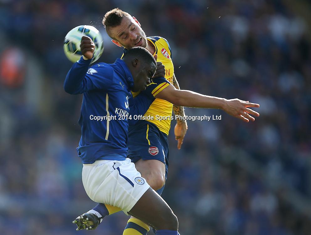 31 August 2014 Premier League football Leicester City v Arsenal - Jeff Schlupp of Leicester (blue shirt) and Mathieu Debuchy battle for the high ball.Photo: Mark Leech
