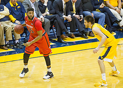 Mar 2, 2016; Morgantown, WV, USA; Texas Tech Red Raiders forward Aaron Ross (15) dribbles while guarded by West Virginia Mountaineers forward Nathan Adrian (11) during the first half at the WVU Coliseum. Mandatory Credit: Ben Queen-USA TODAY Sports
