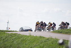 The riders tackle a sharp corner in the first kilometers of the Omloop van Borsele - a 107.1 km road race, starting and finishing in s'-Heerenhoek on April 22, 2017, in Borsele, the Netherlands.