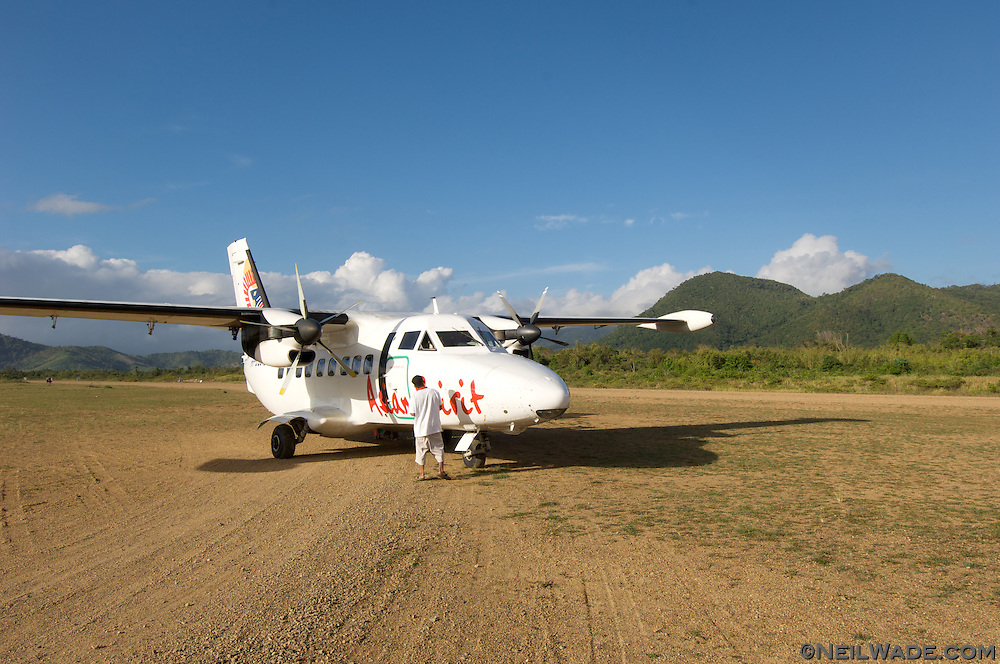 A prop plane lands at the Taytay Airport once a day in remote Taytay, Palawan, Philippines.