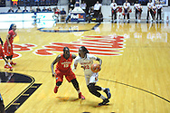 "Mississippi Lady Rebels forward Danielle McCray (22) drives against Georgia Bulldogs forward Krista Donald (15) at the C.M. ""Tad"" Smith Coliseum in Oxford, Miss. on Thursday, January 15, 2015.  (AP Photo/Oxford Eagle, Bruce Newman)"