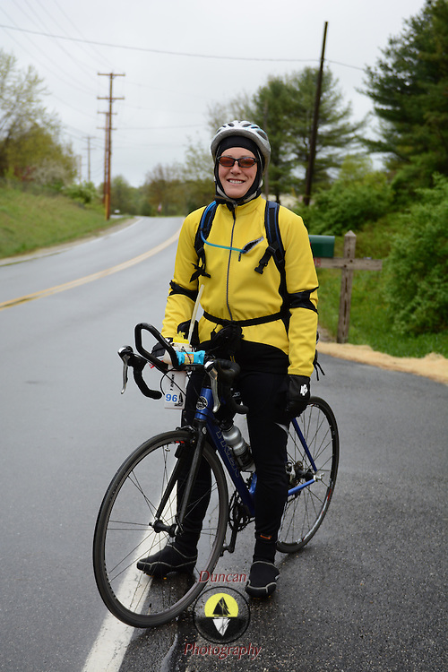 "Yarmouth, Maine - 5/25/13 - Theresa Saxton of Yarmouth is training now for a full-length Triathalon to raise money for Alzheimer's . ""You have to love to train,"" she said, as she set out for a ride in the rain.  Photo © 2013 by Roger S. Duncan."