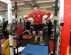 Bristol City's Wade Elliott shows Connor is routine before he trains on the pitch - Photo mandatory by-line: Dougie Allward/JMP - Mobile: 07966 386802 - 01/04/2015 - SPORT - Football - Bristol - Bristol City Training Ground - HR Owen and SAM FM - Live like a footballer for a day