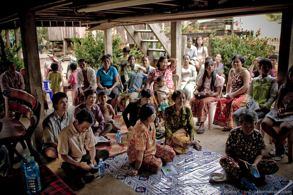 A community talk hosted in downtown Koh Kong hosted by the non governmental organizatin Legal Support for Children and Women on migration. The impoverished residents receive water, cookies, and laundry soap for their time listening to the pitfalls of undocumented migration, like human trafficking, and the means by which they can legally migrate. While LSCW staff acknowledge the policies are in place, they also recognize that the reality of documented migration in Koh Kong, on the Cambodian border with Thailand, is much different than high level bureaucrats profess.