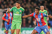 Sunderland defender Patrick Van Aanholt and Crystal Palace forward Wilfried Zaha  during the Barclays Premier League match between Crystal Palace and Sunderland at Selhurst Park, London, England on 23 November 2015. Photo by Simon Davies.