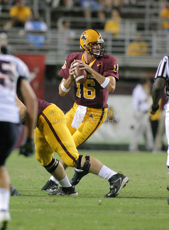 Tempe,AZ - 09-02-04- ASU Sundevils quarterback Andrew Walter drops back to pass in the first half of their season opener aginst UTEP. Walter threw 18 for 37 passes for 274 yards in their 41-9 win. Ross Mason/AiWire