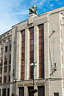 "The International Style Czech National Bank headquarters.  Construction started in 1935, with all phases completed by 1942.  The figure at the top is entitled ""Genius with a Lion."""