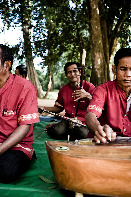 Traditional musicians who are landmine victims at Banteay Srei temple. Angkor, Siem Reap, Cambodia.
