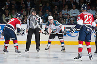 KELOWNA, CANADA - MARCH 23: Tyson Baillie #24 of the Kelowna Rockets stares down Justin Gutierrez #23 of the Tri-City Americans after a scuffle at the face off on March 23, 2014 during game 2 of the first round of WHL Playoffs at Prospera Place in Kelowna, British Columbia, Canada.   (Photo by Marissa Baecker/Getty Images)  *** Local Caption *** Tyson Baillie; Justin Gutierrez;
