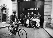 The Chieftains outside Guinness Brewery, St James's Gate, Dublin, meet with some Chinese children on tour.<br />