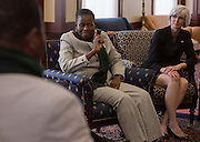 Mrs. Grace Muzila, center, addresses other members of the Ministry of Education Skills and Development, Botswana, along with Ohio University representatives, including Dr. Lorna Jean Edmonds, right, the university's Vice Provost for Global Affairs, before a luncheon at Baker Center on January 21, 2014. The discussion and luncheon were hosted by the Ohio University Center for International Studies.