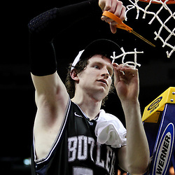 Mar 26, 2011; New Orleans, LA; Butler Bulldogs forward Matt Howard (54) cuts down part of the net following a win over the Florida Gators in the semifinals of the southeast regional of the 2011 NCAA men's basketball tournament at New Orleans Arena. Butler defeated Florida 74-71.  Mandatory Credit: Derick E. Hingle