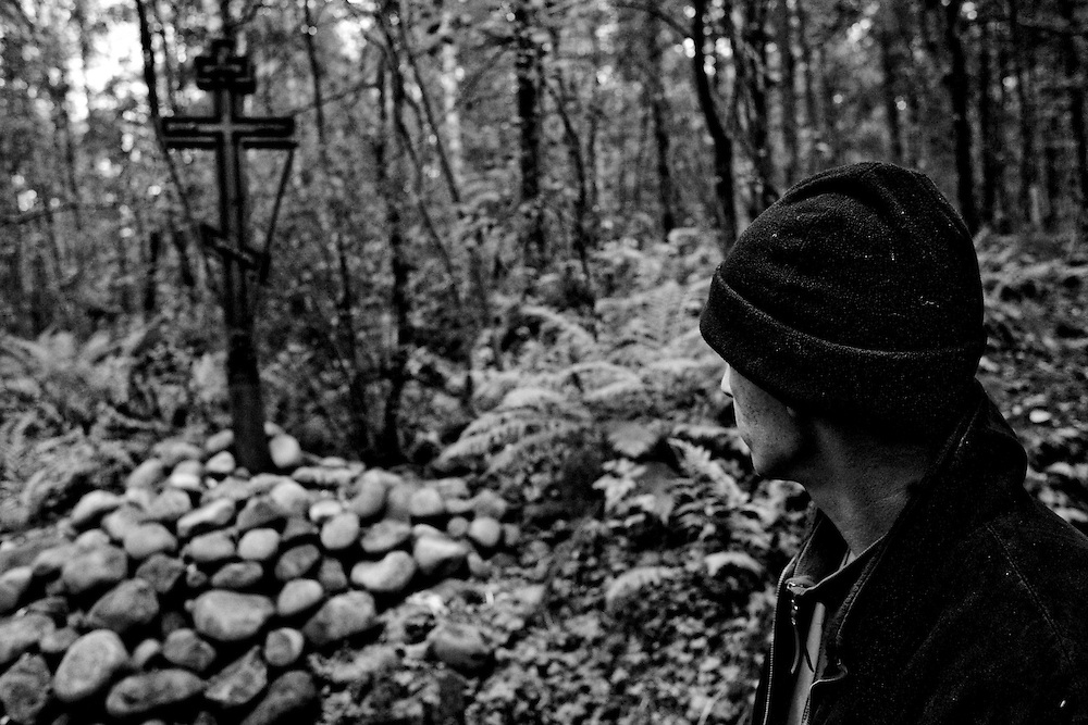 Valera, a former drug user who is now in a rehabilitation program run by the orthodox church, looks at a cross in the woods near the organization's live-in retreat in Sapernoe, Russia, on Saturday, September 15, 2007. About a dozen people at a time live and work at the remote farm, about two hours from St. Petersburg, for a free one year course of treatment.