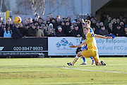 AFC Wimbledon midfielder Jake Reeves (8) shoots at goal during the EFL Sky Bet League 1 match between AFC Wimbledon and Millwall at the Cherry Red Records Stadium, Kingston, England on 2 January 2017. Photo by Stuart Butcher.