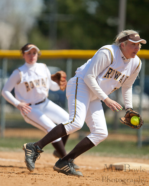 Rowan University sophomore first basemen Stephanie Labas (30) tags out a runner trying to get to first.