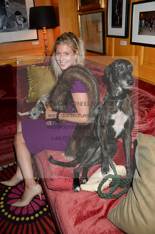 PHILIPPA HOLLAND and her dog Elfie at an exhibition of the 50 best party pictures from Tatler from the past 50 years, held at Annabel's, Berkeley Square, London on 9th September 2013.