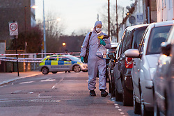 © Licensed to London News Pictures. 25/03/2016. London, UK. A forensic officer at the scene, within the police cordon in Tower Hamlets Road, behind Magpie Close in Forest Gate, east London. Five people have been taken to hospital, with one man in a critical condition. Photo credit : Vickie Flores/LNP